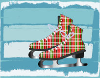 Winter  icy background with plaid  iceskates Stock Photography