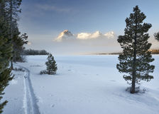 Winter Idaho mountains near a lake with ski trail Stock Images