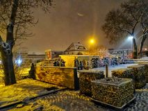 Winter idilic night scene. Night scene of a closed caffe terace royalty free stock photography