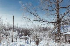 Winter im Dorf lizenzfreie stockbilder