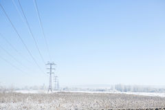 Winter industrial landscape high-voltage lines Royalty Free Stock Photo