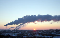 Winter industrial sunset with smoke Royalty Free Stock Images
