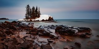 Winter Island. A small island off the shores of Lake Superior on a cold, Minnesota winter sunset royalty free stock photography