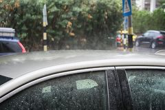 Winter in Israel: Downpour, Heavy rain floods cars and road, raindrops on metal and glass stock photo