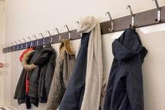 Winter jacket hanging on rack in deposit room. Winter coat hanging on rack in deposit room royalty free stock images