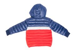 Winter jacket isolated. A stylish blue and red warm down jacket with red lining for the kids is isolated on a white background. stock photos