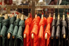 Winter jackets on a hanger in the store close-up royalty free stock images