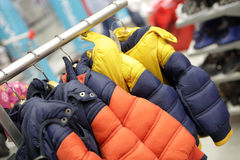 Winter jackets on hangers. Winter children jackets on hangers in a store Royalty Free Stock Photography