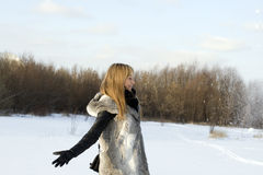 Winter joyful girl. Walking outdoor Stock Photography