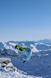Winter jumping. Snowboarder jumping high in the air Royalty Free Stock Photos
