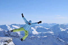 Winter jumping. Snowboarder jumping high in the air Stock Image