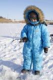 Winter jungen Fischer fischend Stockfotos