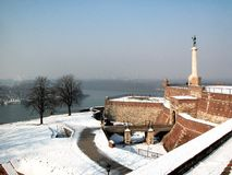 Winter in Kalemegdan. Kalemegdan fortess is the oldest part of Belgrade. On its west part there is a statue of winner stock photo