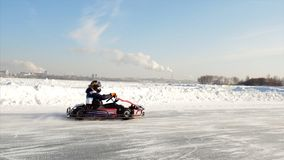 Winter karting competition on the ice track. Clip. Motion of go kart race in winter stock photography
