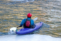 Winter Kayaker in Purple Kayak Stock Photo
