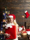 Winter kids. Joyful teenager looking at camera in Christmas at home. Cute little teenager celebrating Christmas royalty free stock photo