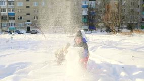 Winter. Kids say the snow at the top. Winter. Kids say the snow at the top and having fun stock video footage