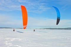 Winter kite sports on the lake royalty free stock image