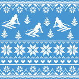 Winter knit pattern - man skiing on blue background Stock Image
