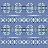 Winter knitted blue white snowflake pattern. Christmas Sweater Design.Traditional scandinavian pattern for knit. Royalty Free Stock Photo