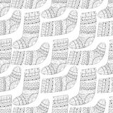 Winter knitted ethnic Sock for gift from Santa seamless pattern Stock Images