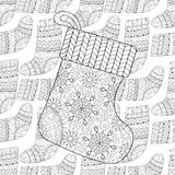 Winter knitted ethnic Sock for gift from Santa on seamless pattern Royalty Free Stock Images