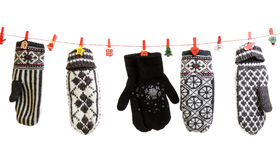 Winter knitted gloves hang Stock Photography