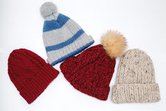 Winter knitted hats on white background Royalty Free Stock Photo