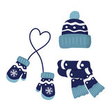 Winter knitted mittens, hat and scar, set in blue color. Winter knitted mittens, beanie hat with pom pom and scar, set in blue color vector illustration Royalty Free Stock Image
