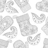 Winter knitted mittens, socks seamless pattern in zentangle  Stock Images
