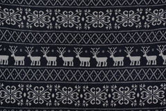 Winter knitted pattern with deer and snowflakes. Background Royalty Free Stock Image