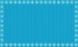 Winter knitted template with fabric background framed with snow Royalty Free Stock Images