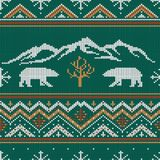 Winter knitted woolen pattern with polar bears. On a background of snow-capped mountains Stock Photography