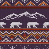 Winter knitted woolen pattern with polar bears. On a background of snow-capped mountains Royalty Free Stock Image