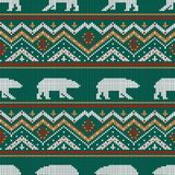 Winter knitted woolen pattern with polar bears. On a background of snow-capped mountains Royalty Free Stock Photo