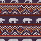 Winter knitted woolen pattern with polar bears. On a background of snow-capped mountains Stock Images
