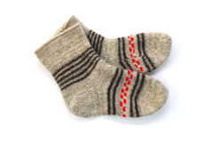Winter knitted woolen socks. On a white background Royalty Free Stock Images