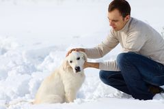 Winter Labrador retriever with owner Stock Images