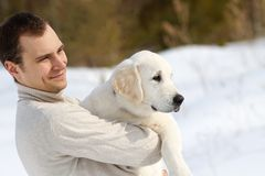 Winter Labrador retriever with owner Royalty Free Stock Photos