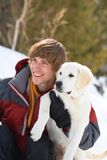 Winter Labrador retriever with owner Stock Image