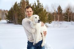 Winter Labrador retriever with owner Royalty Free Stock Photo