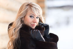 Winter Lady. Winter portrait of a pretty young lady - shallow DOF, focus on eyes Stock Photo