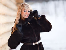 Winter Lady. Winter portrait of a pretty young lady - shallow DOF, focus on eyes Stock Photos
