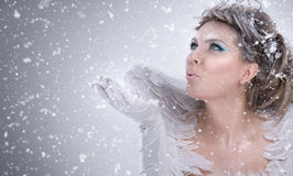 Winter lady  blowing in hand Royalty Free Stock Image
