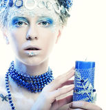 Winter lady with candle Royalty Free Stock Photos