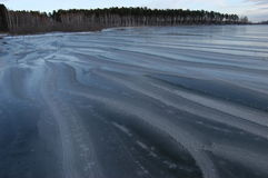 Winter on lake. Beautiful winter patterns on ice Royalty Free Stock Photography