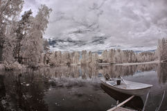 Winter lake and boat Stock Photo
