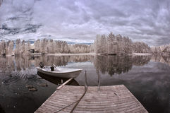 Winter lake and boat Stock Photography