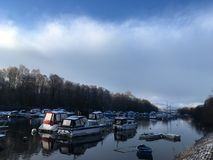 Winter Lake with boats royalty free stock photos