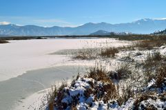 Winter Lake covered with snow. Winter landscape and lake covered with snow in northern Greece Stock Image